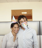 Co-workers joking around at office party — Stock Photo
