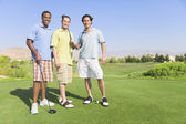 Portrait of three men on golf course — Stock Photo