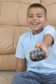 Young boy using remote control — Stock Photo