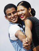 Young couple posing in tango position — Stock Photo