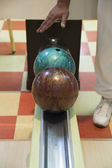Hand reaching for bowling ball — Stock Photo