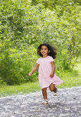 Young girl running down path — Stock Photo
