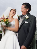 Bride posing for the camera with her father — Stock Photo