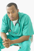 Portrait of male doctor dressed in scrubs — Stock Photo