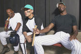 Portrait of baseball players in dugout — Stok fotoğraf