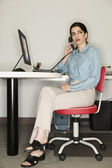 Young businesswoman talking on telephone — Stock Photo
