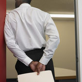 African businessman standing in doorway — Stock Photo