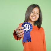 Hispanic girl holding birthday ribbon — Stock Photo