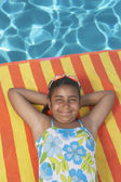 Young girl relaxing on an inflatable raft — Stock Photo