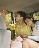 Woman resting against boyfriend on road trip — Stock Photo