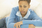 Portrait of African girl on sofa — Stock Photo