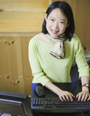 Middle-aged Asian businesswoman smiling — Stock Photo