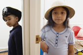 Boy and girl wearing hats — Stock Photo
