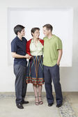 Hispanic mother and adult sons hugging — Stock Photo