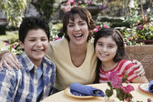 Hispanic mother and children at table — Stock Photo