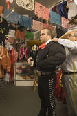 Young man trying on a matador outfit — Stock Photo