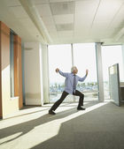 Businessman doing Tai Chi in the office — Стоковое фото