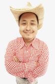 Studio shot of Asian man wearing cowboy hat — Stock Photo