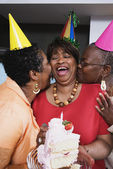 Three middle-aged African women at birthday party — Stock Photo