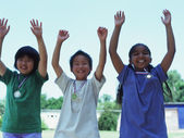 Portrait of children raising hands — Stock Photo