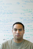 Portrait of man in front of white board — Stock Photo