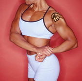 Female body builder with bionic shoulder — Stock Photo