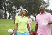 Two couples play golf together — Stock Photo