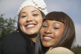 Two African American women smiling and hugging — Stock Photo