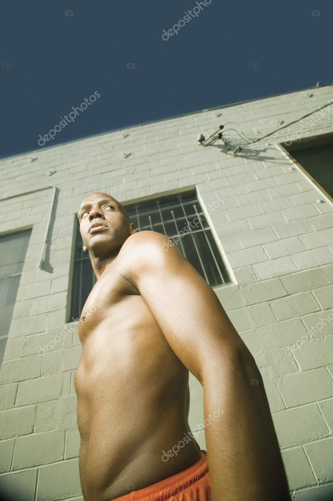 Low angle view of young male athlete's body — Stock Photo #13225791