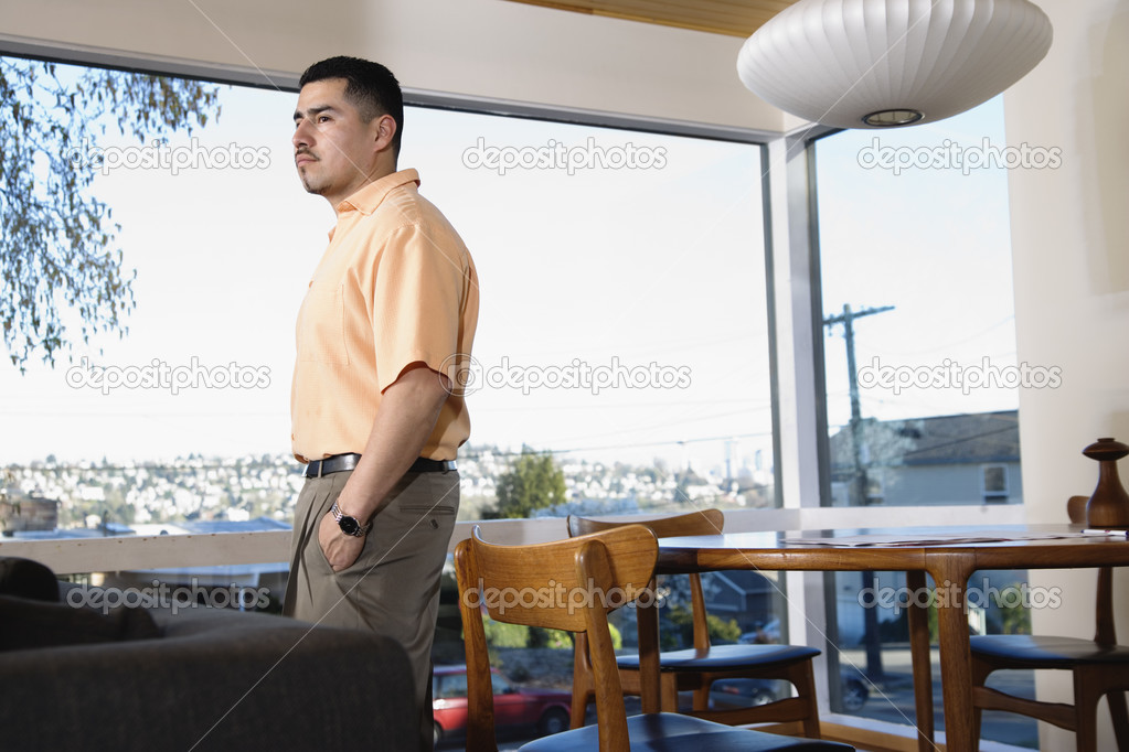 Man at home standing near window — Stock Photo #13226521