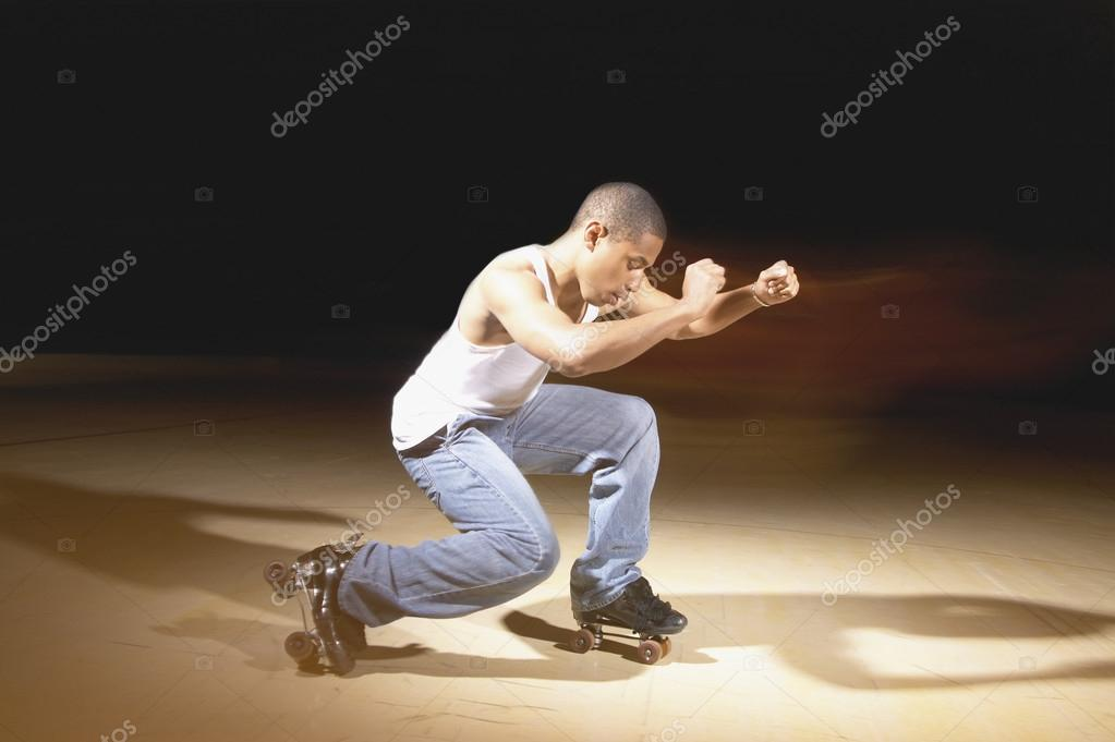Young man performing dance on roller skates  Stock Photo #13226994