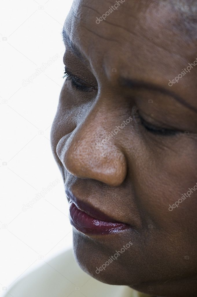 Close-up of middle-aged woman's face  Stock Photo #13227057