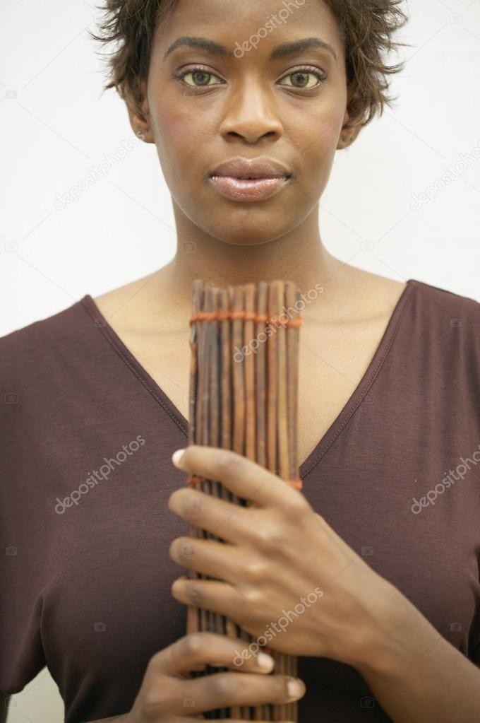 Portrait of woman holding twigs — Stock Photo #13228103