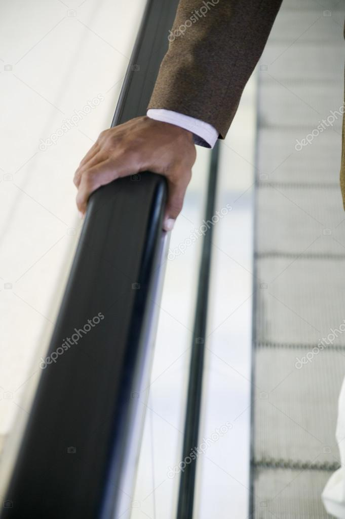 Businessman's hand on rail — Stock Photo #13228369