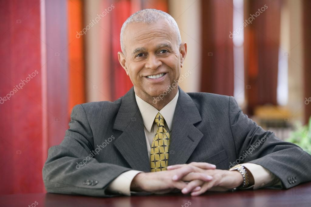 Businessman smiling for the camera — Stock Photo #13229489