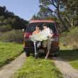 Couple reading a map on dirt trail — Stock Photo #13230331