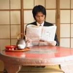 Businessman reading newspaper — Stock Photo #13230559