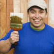 Hispanic man painting fence — Stock Photo #13231669
