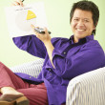 Portrait of businessman holding pie chart — Stock Photo #13233282
