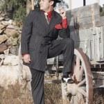 Hispanic man in tango suit next to wagon — Stock Photo #13238981