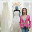 Foto Stock: Young womstanding in bridal boutique