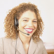 Portrait of businesswoman with telephone headset — Stock Photo
