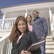 Portrait of realtor with couple — Stock Photo
