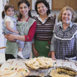 Female Hispanic family members smiling in the kitchen — Stock Photo #13230016