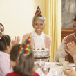 Family birthday party for Hispanic grandmother - Stockfoto