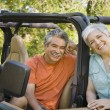 Royalty-Free Stock Photo: Senior Hispanic couple with jeep