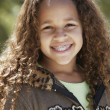 Stock Photo: Africgirl with braces smiling outdoors