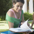 Student reading on the grass — Stock Photo