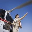 Asibusinesswomon helicopter — Stock Photo #13230133