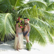 Pacific Islander couple in traditional dress on beach — Stock Photo